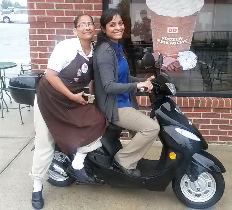 Vee (on left) with 2015 Solano 50cc Scooter