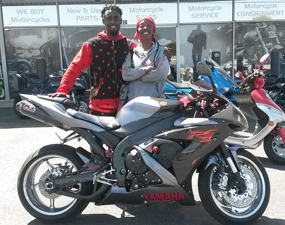George R. with 2004 Yamaha YZF-R1 (George R's. wife and son pictured)