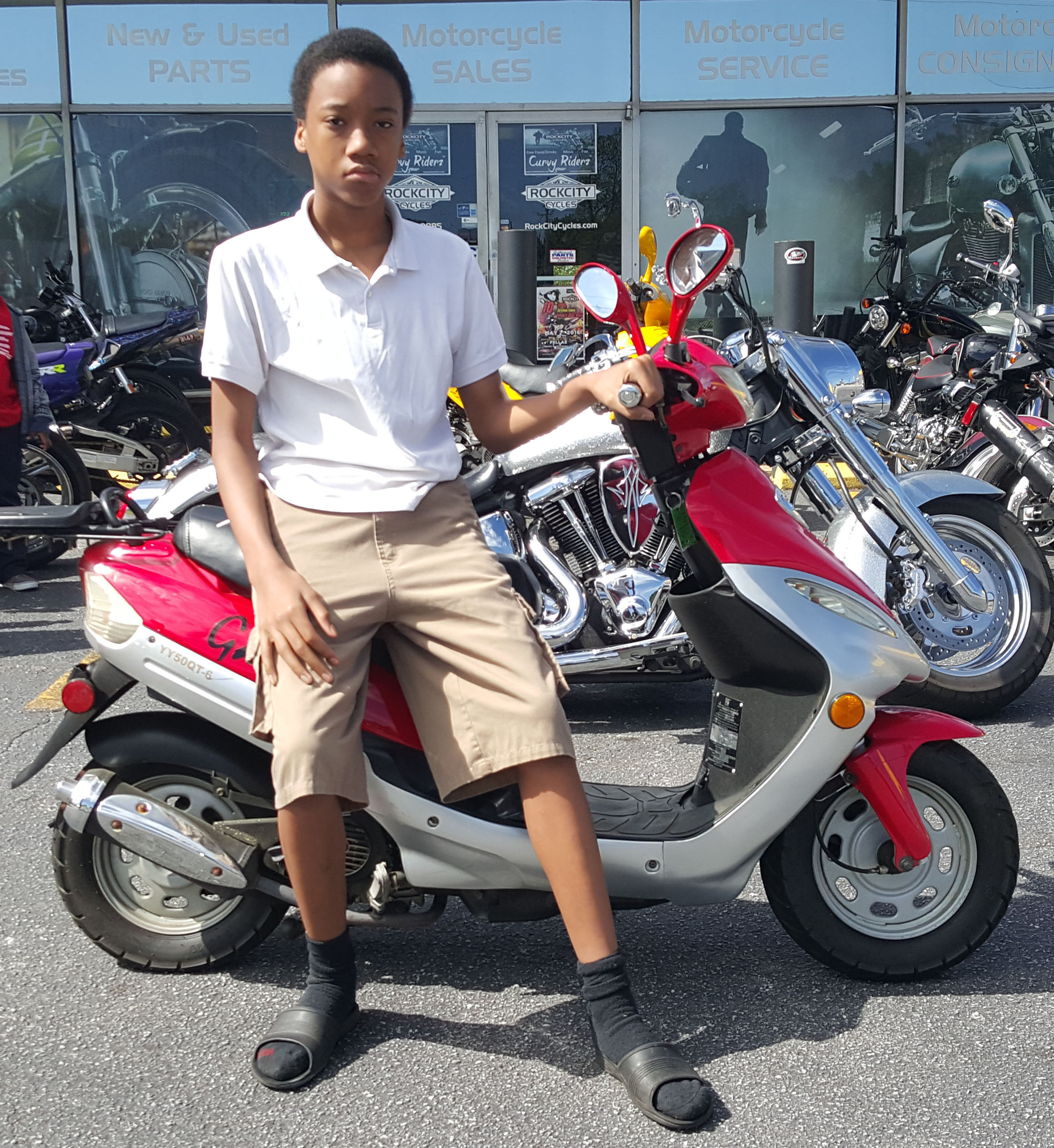 Lynn A. with 2014 Gator 50cc Scooter