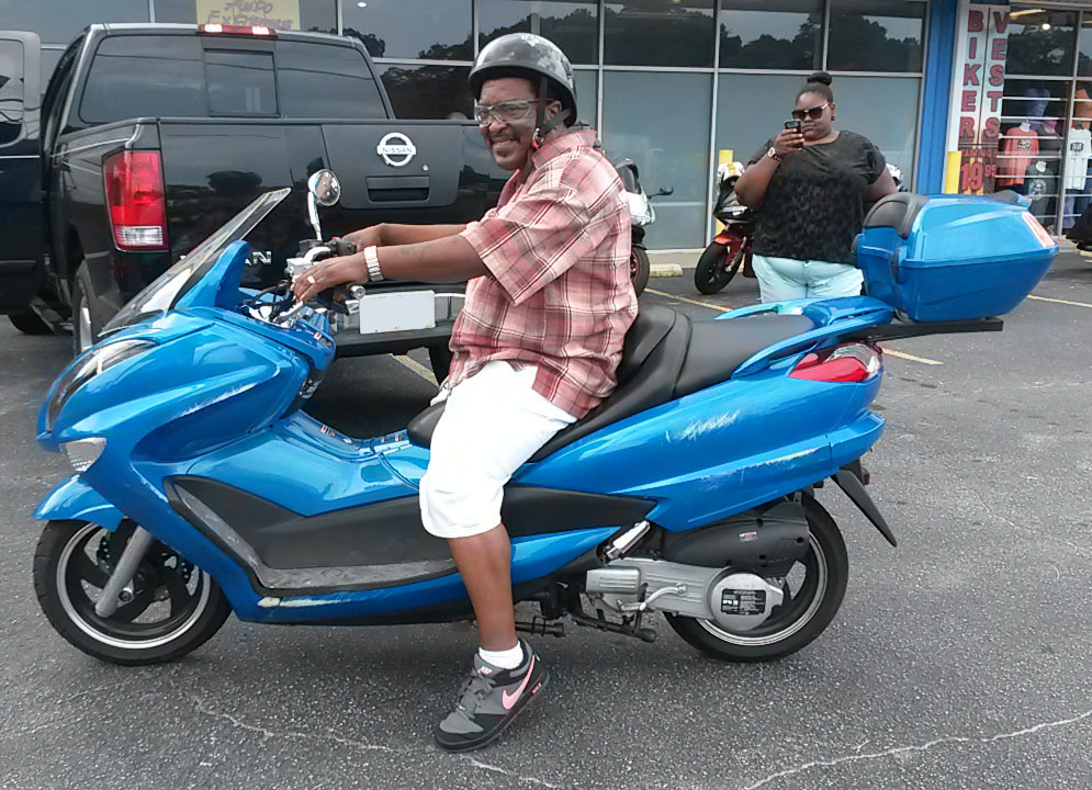 Wallace with 2012 Daix Zhenhua 150cc Scooter