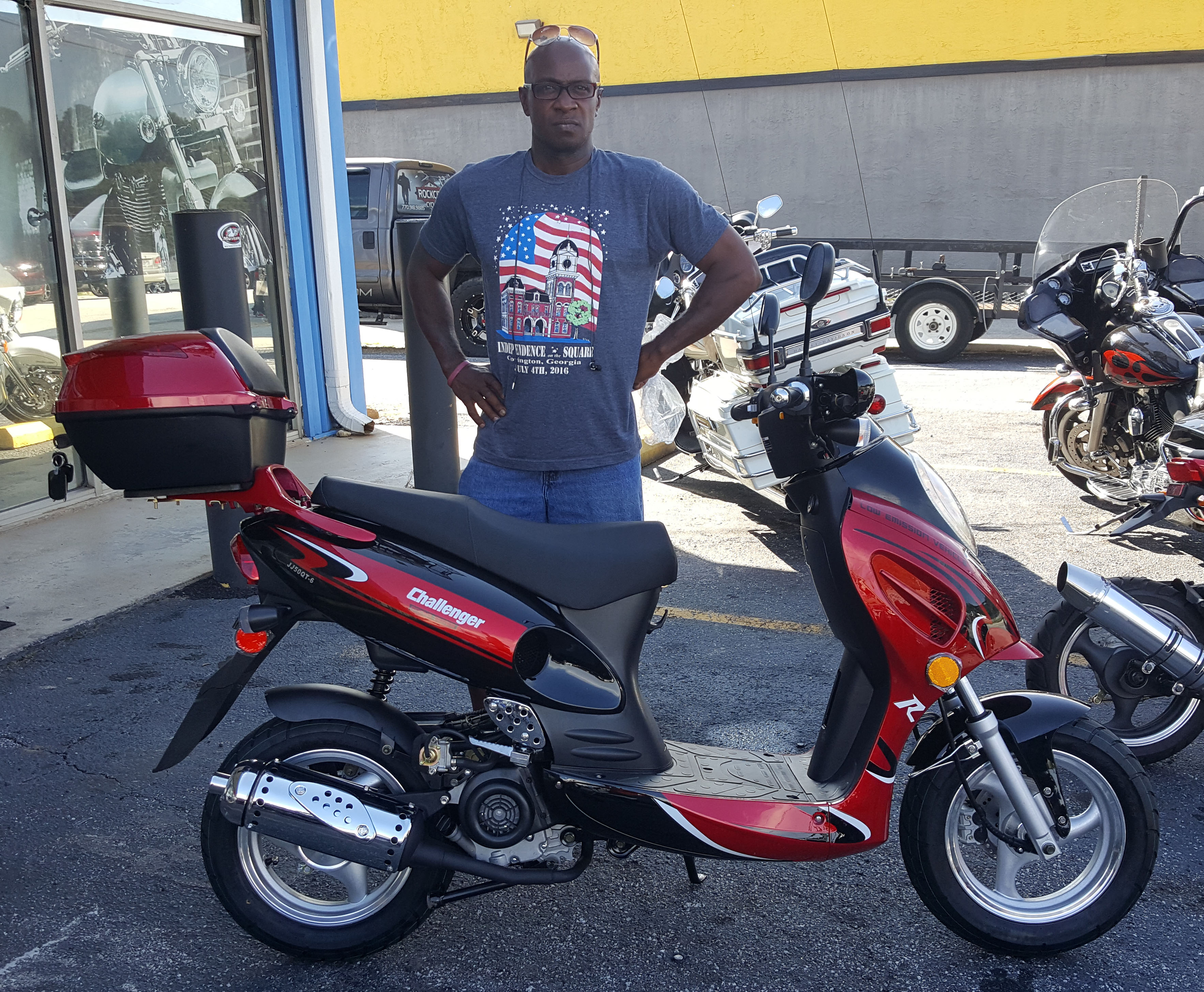 Herbert J. with his 2017 Gator 50cc Scooter