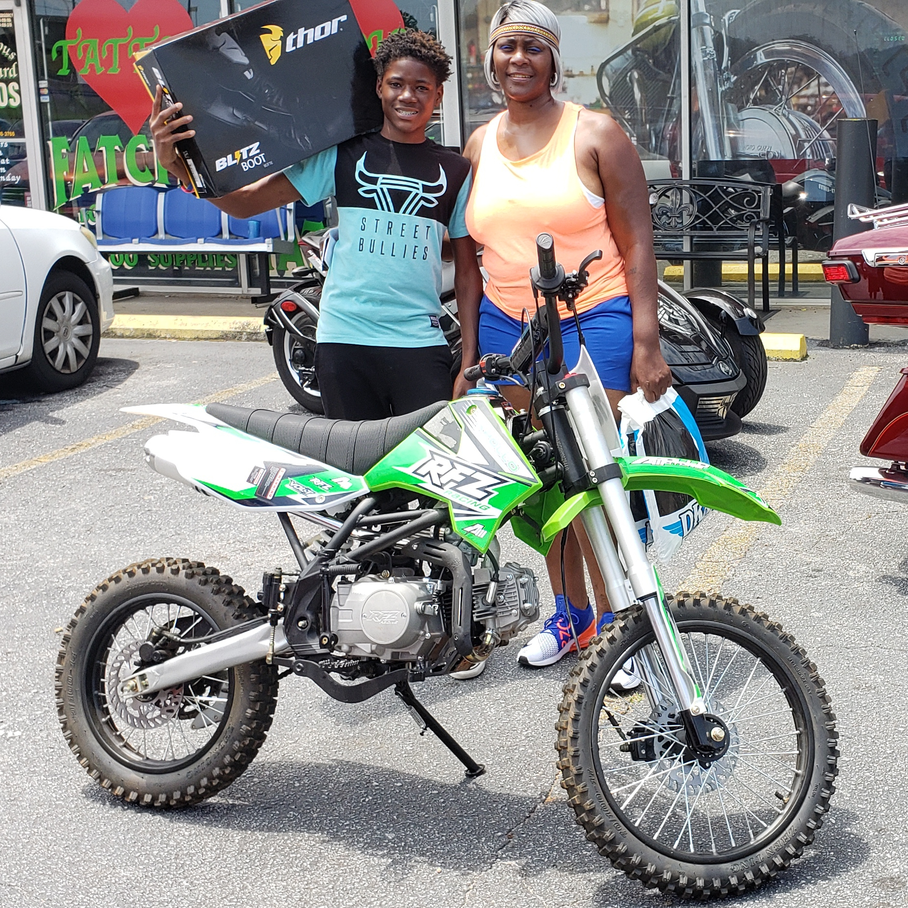 Sundra P. with her 2017 Apollo X18 15cc Dirt Bike