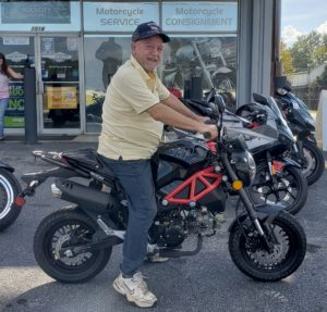 Arthur O. with his 2018 Rocket 150cc Scooter
