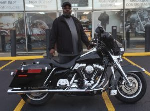 Dwayne W. with his 2001 Harley-Davidson FLHTP Police